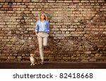 young woman with chihuahua in old city. - stock photo
