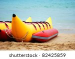 banana boat lays on a beach - stock photo