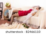 Crime scene in a retro style. Lifeless  woman lying on the sofa - stock photo