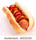 hot dog with sausage, mustard,ketchup and bread over white background - stock photo