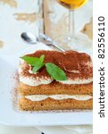 Traditional Italian dessert tiramisu on white plate - stock photo
