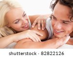 laughing couple lying while... | Shutterstock . vector #82822126