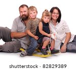 Happy family resting on a white background, - stock photo