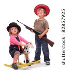 Boy and girl dressed in retro costume from American Old West. - stock photo
