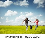 young happy couple running on a ... | Shutterstock . vector #82906102