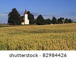 Small photo of Rural church in field. Igene. Latvia.