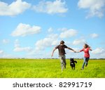 young happy couple running on a ... | Shutterstock . vector #82991719