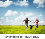 young happy couple running on a ...   Shutterstock . vector #83041831