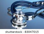 stethoscope on blue background   Shutterstock . vector #83047015