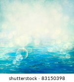 Small waves on water surface in motion blur. - stock photo