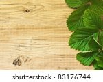 strawberry leaves on wooden...   Shutterstock . vector #83176744