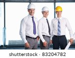 Men in helmets on a construction site - stock photo