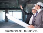 Men are checking on a construction site - stock photo