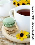 french dessert   macaroons and a cup of tea - stock photo