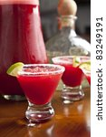 red margaritas with lime, studio shot - stock photo