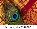 indian silk saries with peacock feather - stock photo