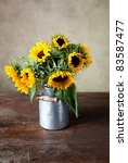 Still Life with Sunflowers in old Milk Can - stock photo