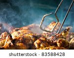 Barbecue chicken with cherbs on Grill - stock photo