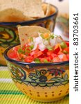 Bowl of spicy salsa with tomato, garlic and Serrano pepper - stock photo