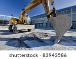 construction equipment parked at work site - stock photo