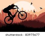 Mountain bike trial rider in skyscraper city landscape illustration - stock vector