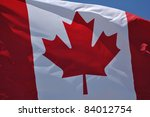 Close-up of the Flag of Canada Waving in the Breeze - stock photo