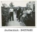 Vintage photo of family in the garden (thirties) - stock photo