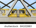 yellow moving tram on a bridge... | Shutterstock . vector #84102883