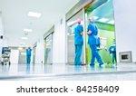 Blurred Figures Wearing Medica...