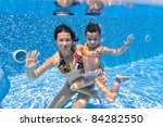 Underwater Smiling Family In...