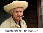 CUBA – MARCH 17: Picturesque Cuban old man smoking Cuban cigar in Trinidad. Cuba is famous of its cigars, on March 17, 2010 in Cuba. - stock photo