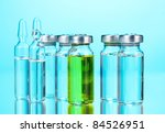 medical ampoules on blue...   Shutterstock . vector #84526951