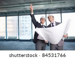 Two men in hard hats at construction site - stock photo