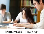 students working on a paper... | Shutterstock . vector #84626731