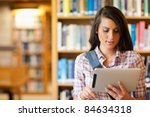 young focused student using a...   Shutterstock . vector #84634318