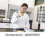 scientist pouring a liquid in... | Shutterstock . vector #84635065