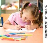 cute little girl is drawing... | Shutterstock . vector #84708676