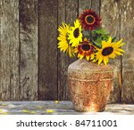 Sunflowers On A Grunge Wood...
