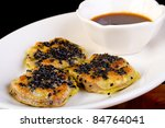 Chinese Dim Sum with black sesame seeds - stock photo