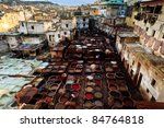 FEZ, MOROCCO - DEC 22: Colorful tanning pools and unidentified workers at a traditional leather tannery,  located in the heart of a neighborhood in a crowded Fez suburban Dec 22, 2009 in Fez, Morocco. - stock photo