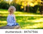 angry little girl sitting... | Shutterstock . vector #84767566