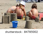 children in the sand - stock photo