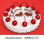 Celebration: cake with cherries over red background - stock photo