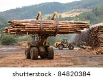 Large log loader and operations in the log yard at a conifer log mill near Roseburg Oregon - stock photo