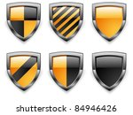 Shield security icons, in black & yellow color on white, vector illustration - stock vector