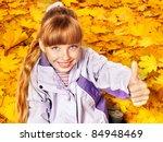 Child in autumn orange leaves. Outdoor. - stock photo