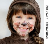 Cute little girl with face painted wearing knit brown hood - stock photo