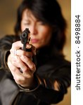 a dark hair woman firing from... | Shutterstock . vector #8498884