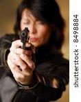 a dark hair woman firing from...   Shutterstock . vector #8498884