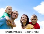 portrait of a cute family on a... | Shutterstock . vector #85048783